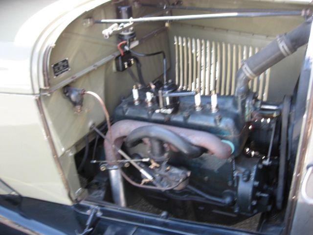 Early Model Car Has Seat On Rear Fender