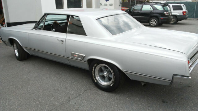 1965 Oldsobile Cutlass Holiday coupe with 442 options, or